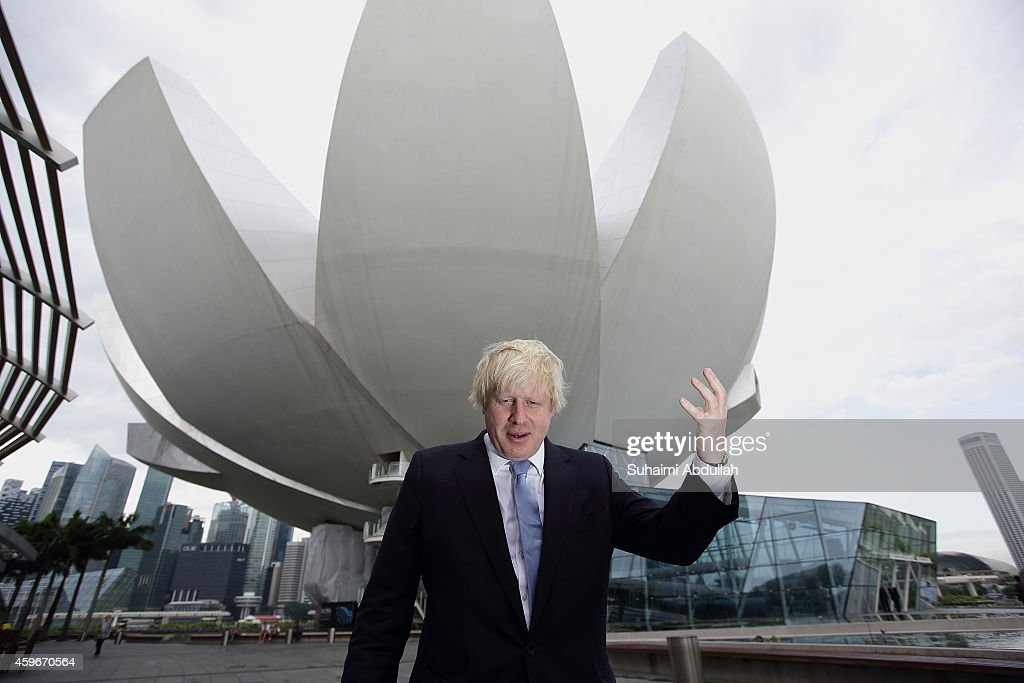 Mayor of London Boris Johnson takes in the sight outside the ArtScience Museum at Marina Bay prior to speaking at the FinTech event at the ArtScience...