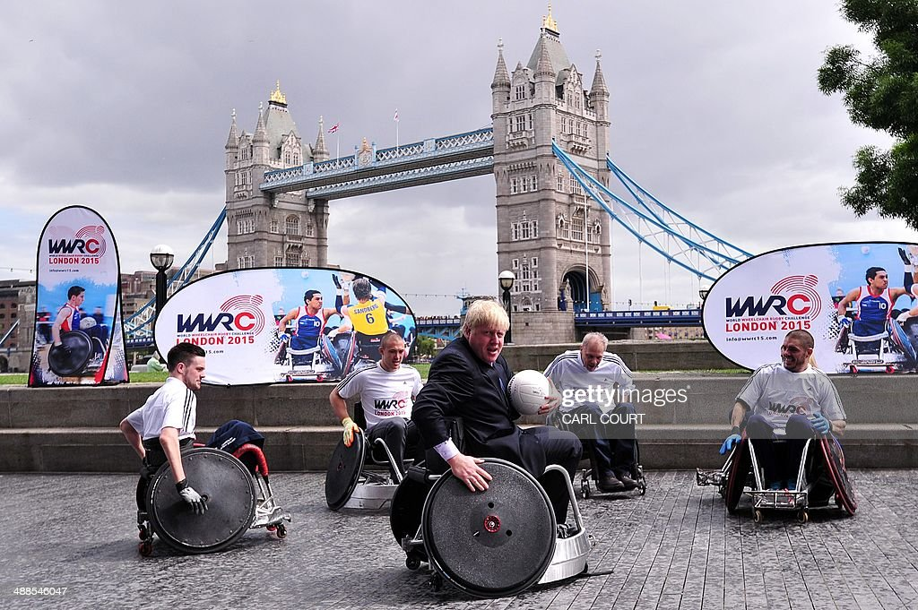 Mayor of London Boris Johnson (C) takes part in wheelchair rugby demonstration in central London on May 7, 2014 to officially launch the World Wheelchair Rugby Challenge which will take place in October 2015 in the Copper Box Arena at Queen Elizabeth Olympic Park in east London. AFP PHOTO / CARL COURT