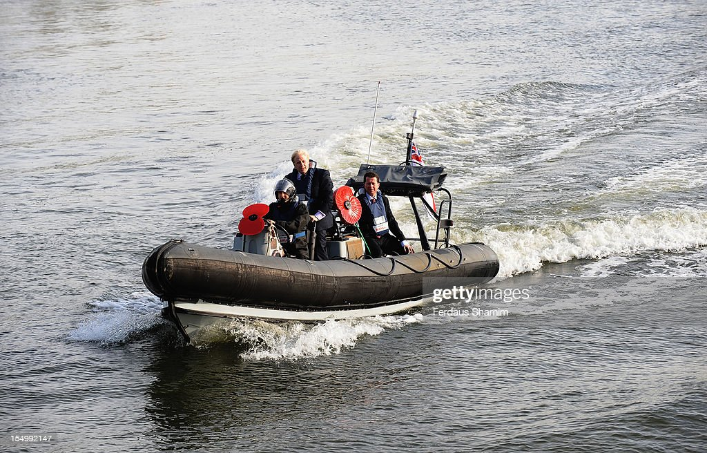 Mayor of London Boris Johnson travels in an inflatable boat as he attends a photocall to launch the largest ever London Poppy Day, aboard HMS Severn on October 30, 2012 in London, England.