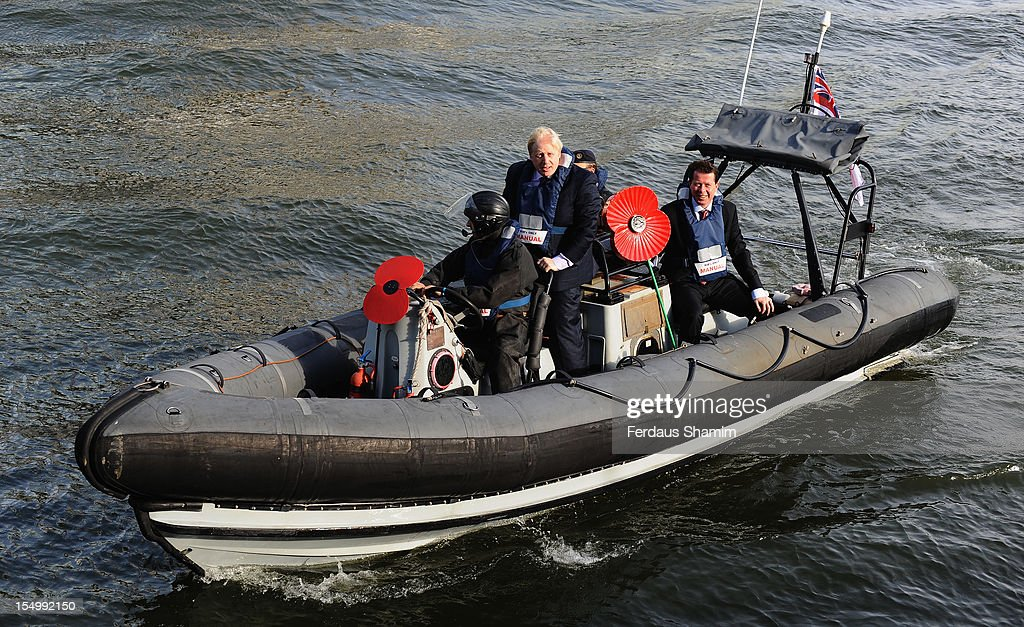 Mayor of London <a gi-track='captionPersonalityLinkClicked' href=/galleries/search?phrase=Boris+Johnson&family=editorial&specificpeople=209016 ng-click='$event.stopPropagation()'>Boris Johnson</a> travels in an inflatable boat as he attends a photocall to launch the largest ever London Poppy Day, aboard HMS Severn on October 30, 2012 in London, England.