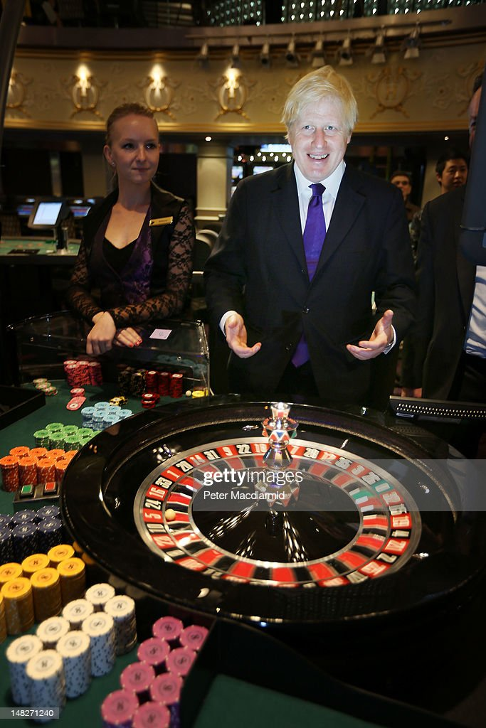 Mayor of London Boris Johnson tries out a roulette wheel at The Hippodrome Casino near Leicester Square on July 13, 2012 in London, England. The new casino has five floors and 90,000 square feet of slot machines, blackjack and roulette tables.