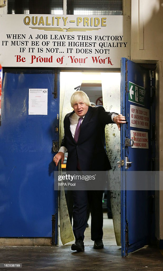 Mayor of London <a gi-track='captionPersonalityLinkClicked' href=/galleries/search?phrase=Boris+Johnson&family=editorial&specificpeople=209016 ng-click='$event.stopPropagation()'>Boris Johnson</a> visits McKenna Bothers, makers of destination boards, in Middleton during the second day of the Conservative Party Conference in Manchester Town Hall on September 30, 2013 in Manchester, England. Chancellor of the Exchequer George Osborne has unveiled a Government plan for long-term unemployed people to undertake work placements in order to receive their benefits.