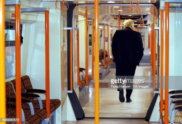 Mayor of London Boris Johnson walks through the 'worm design' carriage in the first of 54 new trains for Transport for London's Overground network...