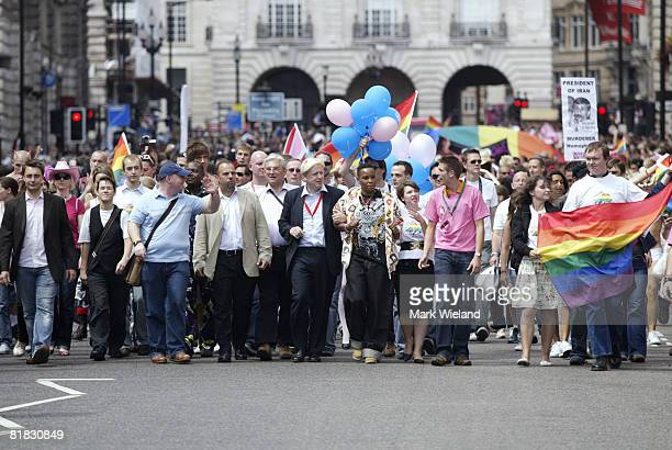 Mayor of London Boris Johnson walks with the crowd during the Gay Pride parade on July 5 2008 in London The parade consists of celebrities floats and...