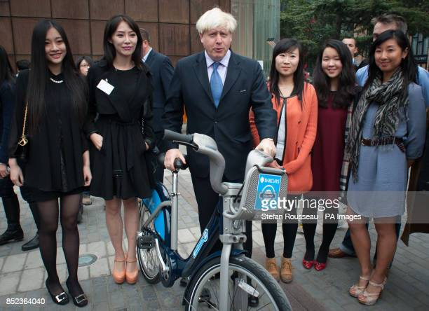 Mayor of London Boris Johnson with a 'Boris Bike' begins a sixday trade mission meeting former and current students from the UK and Beijing at the...