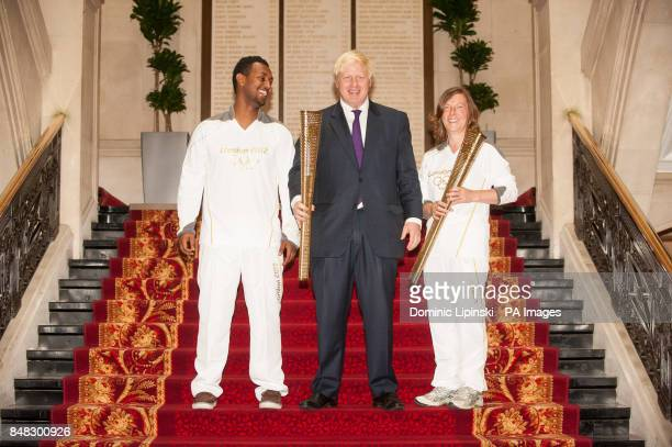 Mayor of London Boris Johnson with London Olympic Torch bearers Samuel Berhanu from Plaistow and Carol Margetts from Ealing who will carry the...