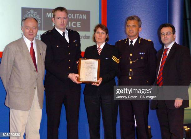 Mayor of London Ken Livingstone and Phil Woolas MP stand with the British Transport Service's Chief Constable Ian Johnston PC Gerard Collins and PC...