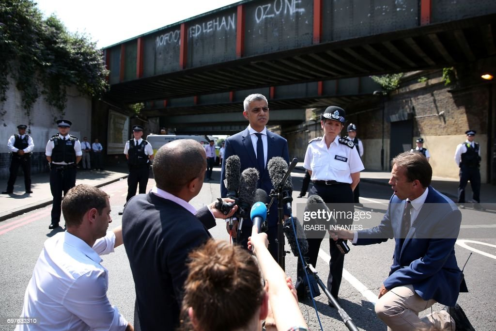 Mayor of London Sadiq Khan, (C) and Metropolitan Police Commissioner Cressida Dick give a statement to the media near the scene of an attack in the Finsbury Park area of north London following a vehicle attack on pedestrians, on June 19, 2017. Ten people were injured when a van drove into a crowd of Muslim worshippers near a mosque in London in the early hours of Monday, and a man who had been taken ill before the attack died at the scene. / AFP PHOTO / Isabel INFANTES