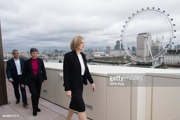 Mayor of London Sadiq Khan newly appointed Metropolitan Police commissioner Cressida Dick and Home Secretary Amber Rudd arrive to pose for a photo at...