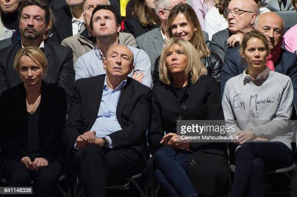 Mayor of Lyon Gerard Collomb and Emmanuel Macron's wife Brigitte Trogneux attend a meeting of former French Economy Minister Founder and Leader of...
