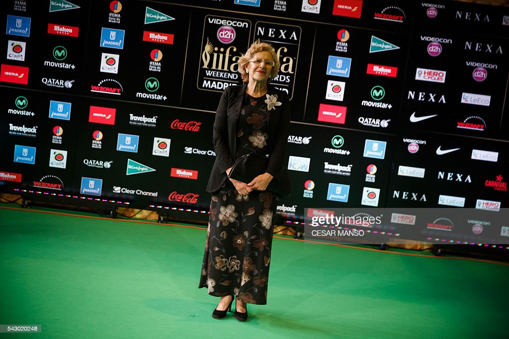 Mayor of Madrid Manuela Carmena poses on the green carpet few moments before the 17th edition of IIFA Awards (International Indian Film Academy Awards) in Madrid on June 25, 2016. The IIFA Awards are presented annually by the International Indian Film Academy to honour both artistic and technical excellence of professionals in Bollywood, the Hindi language film industry. / AFP / CESAR