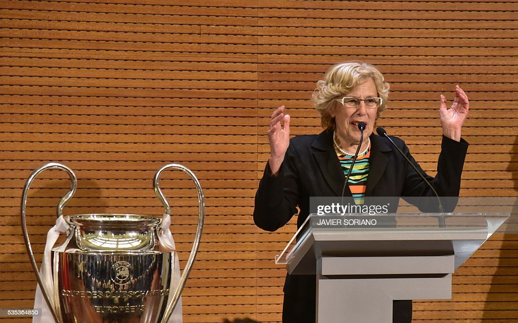 Mayor of Madrid Manuela Carmena speaks beside the trophy in Madrid town hall on May 29, 2016 after Real Madrid won the UEFA Champions League final foobtall match against Club Atletico de Madrid, held in Milan, Italy on May 28, 2016. / AFP / JAVIER