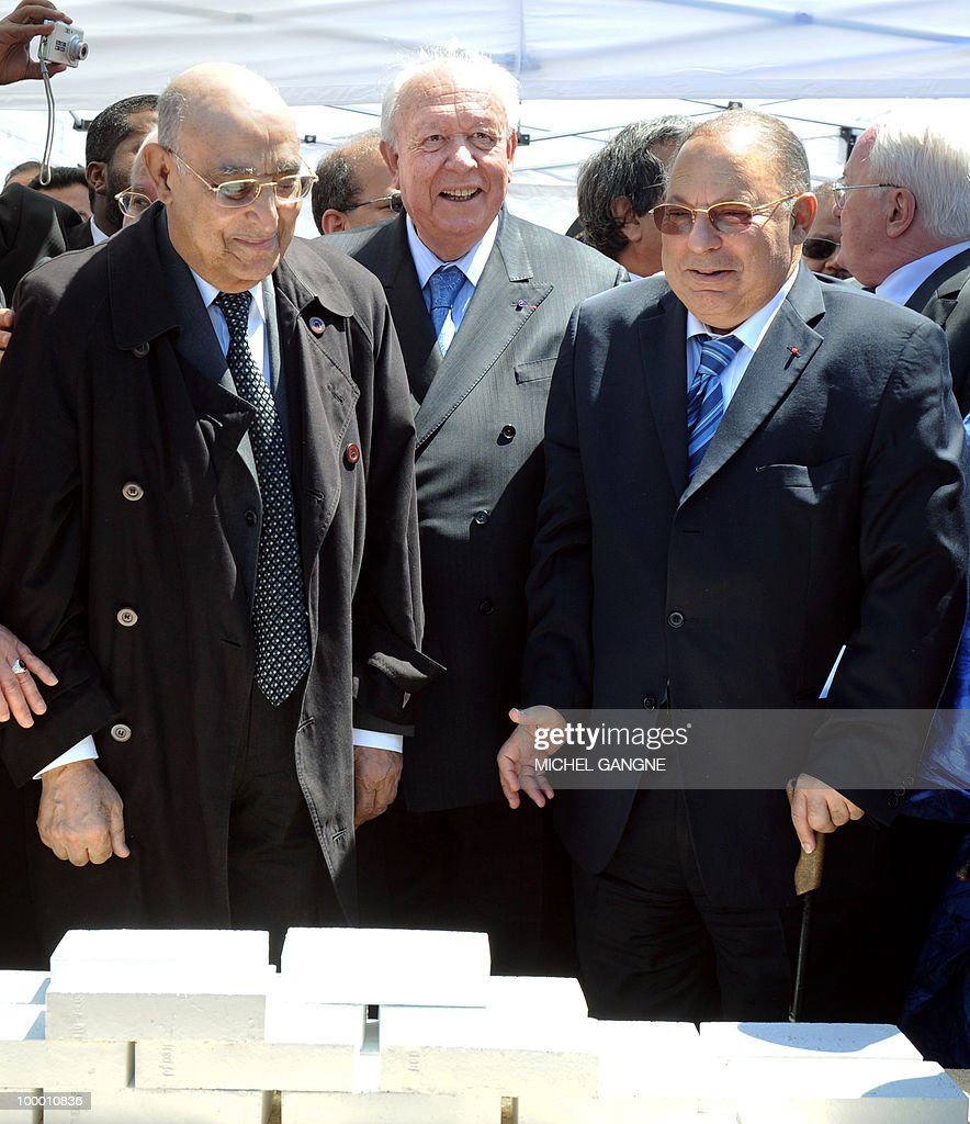 Mayor of Marseille jean-Claude Gaudin (C) flanked by Algeria ombudsman in France Mayssoun Sbih (L) and Paris mosque's rector Dalil Boubakeur (R) takes part in a ceremony on May 20, 2010 to launch building work on a mega-mosque in Marseille southern France. With a minaret soaring 25 metres (82 feet) high, the Grand Mosque will hold up to 7,000 people in its prayer room and the complex will also boast a Koranic school, library, restaurant and tea room when it opens in 2012.