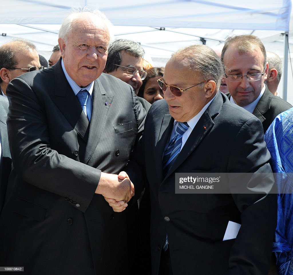 Mayor of Marseille Jean-Claude Gaudin shakes hands with Paris mosque's rector Dalil Boubakeur (R) during a ceremony on May 20, 2010 to launch building work on a mega-mosque in Marseille southern France. With a minaret soaring 25 metres (82 feet) high, the Grand Mosque will hold up to 7,000 people in its prayer room and the complex will also boast a Koranic school, library, restaurant and tea room when it opens in 2012.