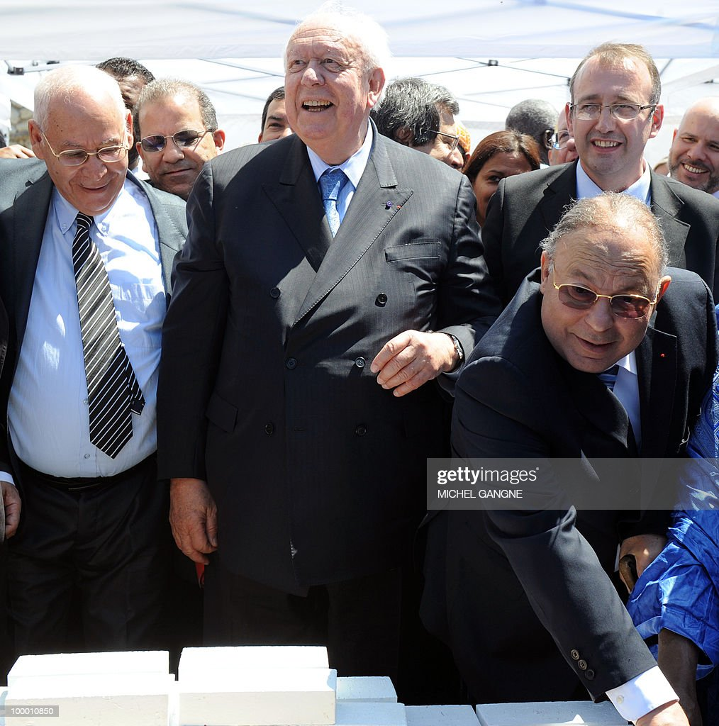 Mayor of Marseille Jean-Claude Gaudin (C) stands with Paris mosque's rector Dalil Boubakeur (R) as he lays the cornerstone on May 20, 2010 to launch building work on a mega-mosque in Marseille southern France. With a minaret soaring 25 metres (82 feet) high, the Grand Mosque will hold up to 7,000 people in its prayer room and the complex will also boast a Koranic school, library, restaurant and tea room when it opens in 2012.
