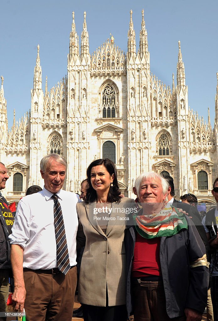 Mayor of Milan Giuliano Pisapia and President of the Chamber of Deputies Laura Boldrini attend a march to mark the 68th Festa Della Liberazione on April 25, 2013 in Milan, Italy.The symbolic celebration day commemorates the Liberation of Italy and the Italian resistance movement after the Nazi occupation army left Northern Italy on April 25, 1945.
