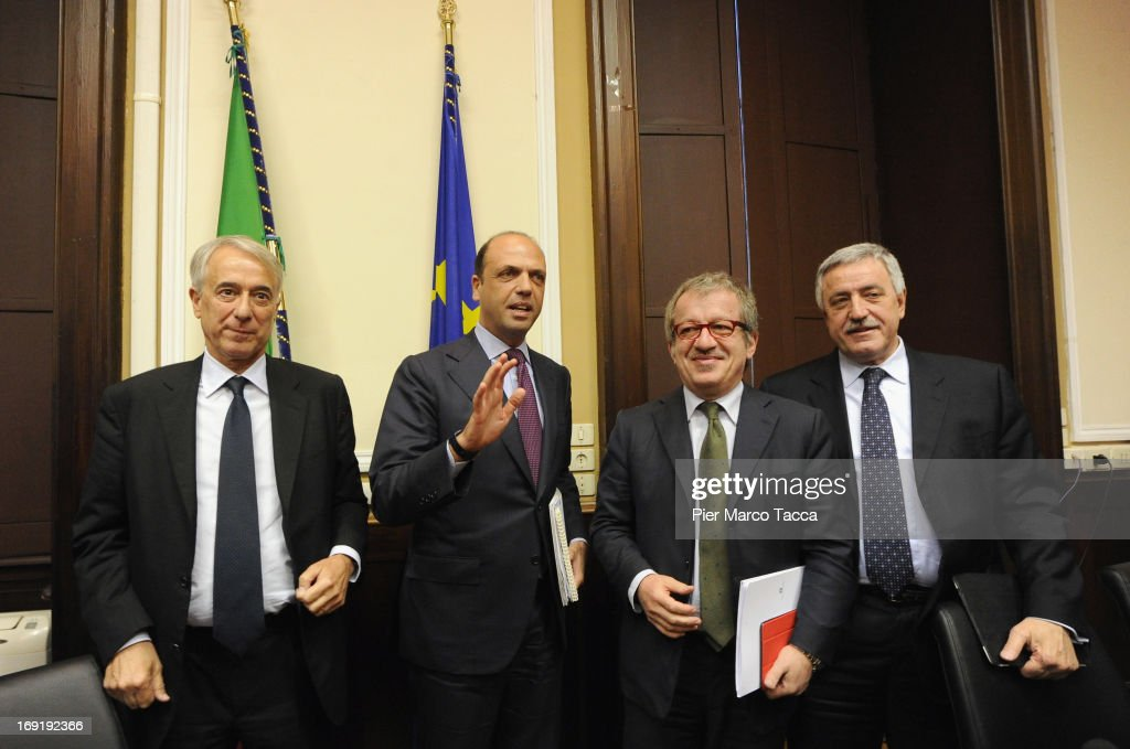 Mayor of Milan Giuliano Pisapia, Interior Minister <a gi-track='captionPersonalityLinkClicked' href=/galleries/search?phrase=Angelino+Alfano&family=editorial&specificpeople=5101299 ng-click='$event.stopPropagation()'>Angelino Alfano</a>, Governor of Lombardy <a gi-track='captionPersonalityLinkClicked' href=/galleries/search?phrase=Roberto+Maroni&family=editorial&specificpeople=665299 ng-click='$event.stopPropagation()'>Roberto Maroni</a> and President of Milan province Guido Podesta attend a meeting on safety after a recent spate of violence in Milan, at Prefettura on May 21, 2013 in Milan, Italy. The violence, including a pickaxe rampage by a Ghanian immigrant two weeks ago that left three dead and a midday Molotov-cocktail robbery earlier today in the city center, is seeing an increase in the number of police on the streets.