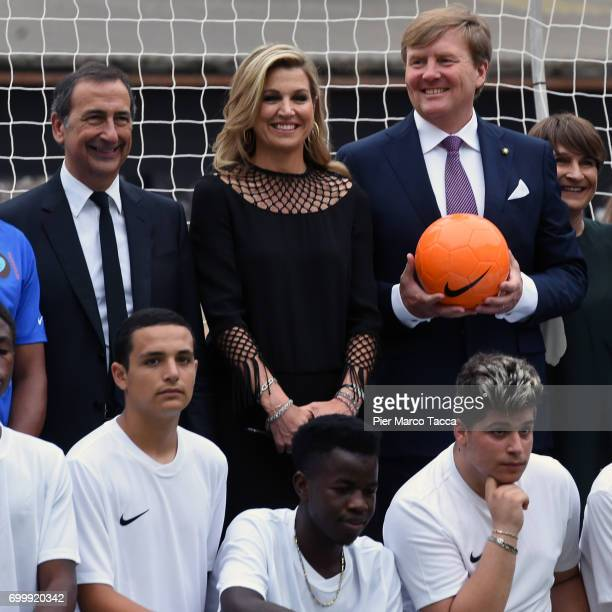 Mayor of Milan Giuseppe Sala Queen Maxima and King WillemAlexander of The Netherlands attend a football clinic for integration organized by Italian...