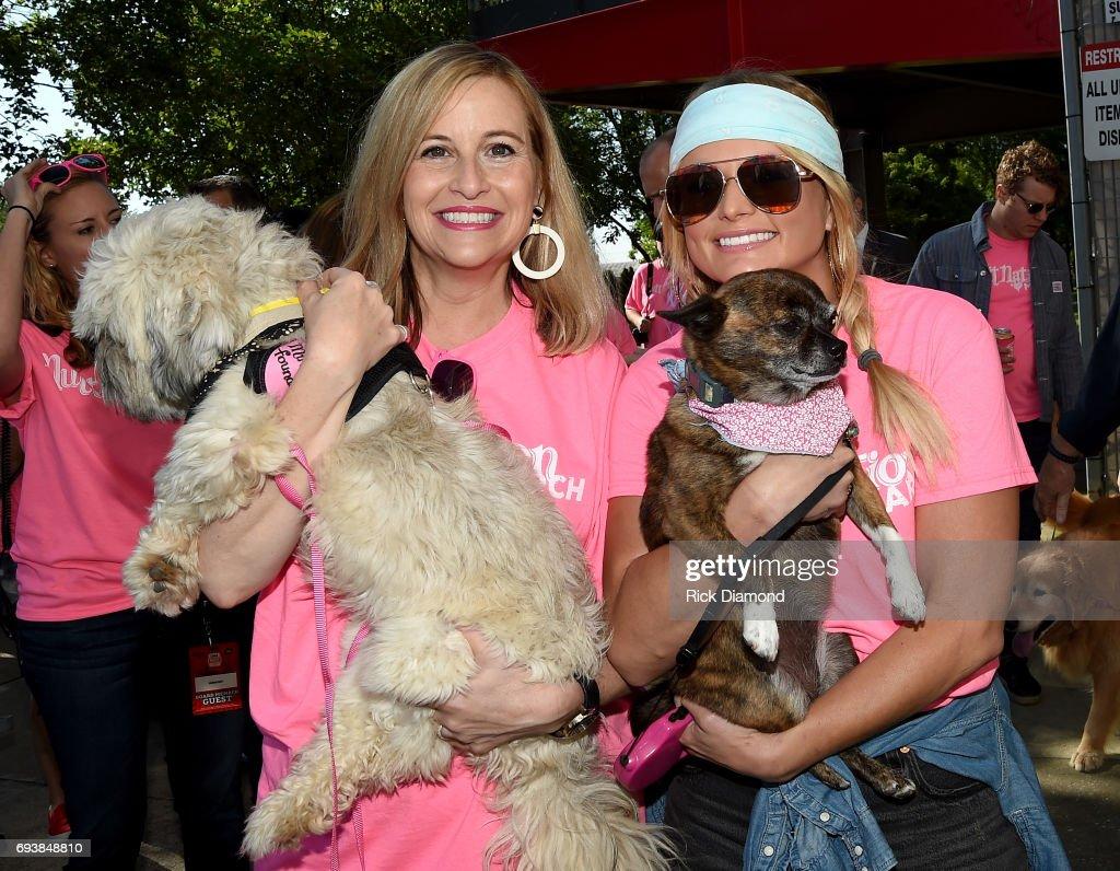 Mayor of Nashville Megan Barry and singer-songwriter Miranda Lambert attend the Miranda MuttNation March at Nissan Stadium on June 8, 2017 in Nashville, Tennessee.