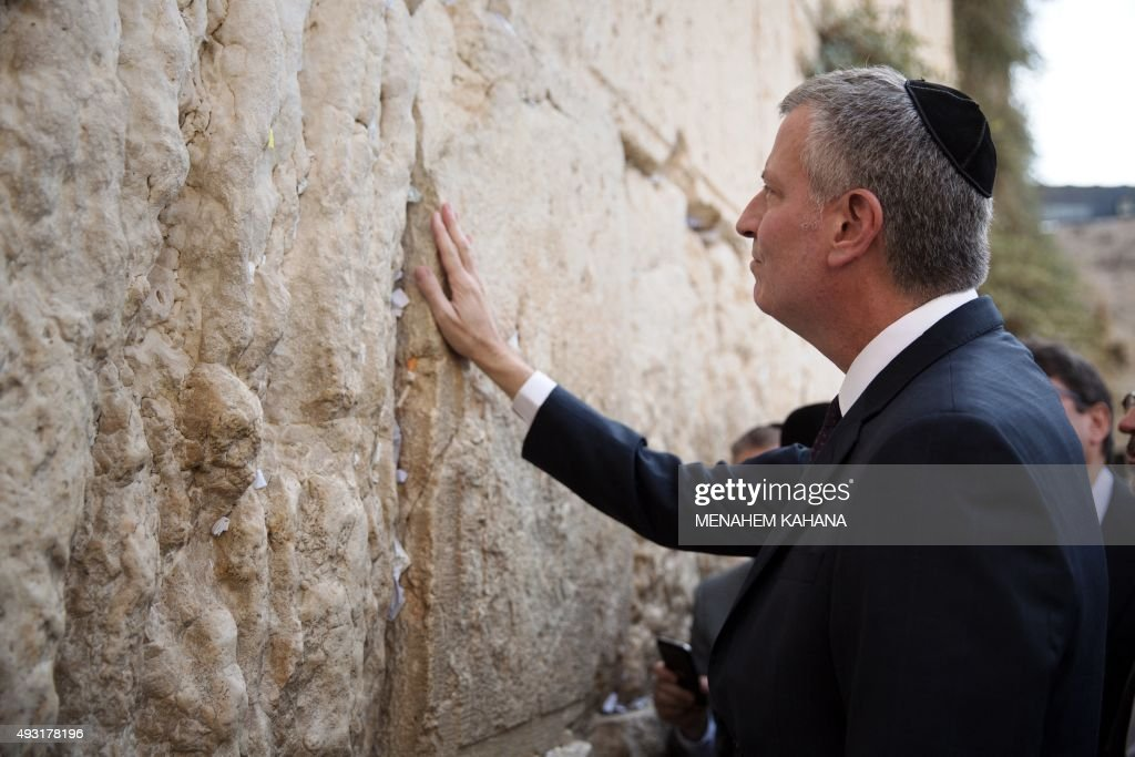 Mayor of New York Bill de Blasio prays after placing a wish paper at the Western Wall Judaism's holiest site in the old city of Jerusalem on October...