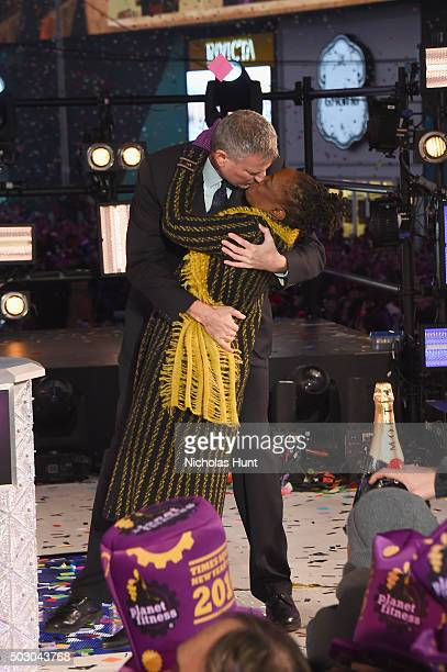 Mayor of New York City Bill De Blasio kisses First Lady of New York City Chirlane McCray at midnight on New Year's Eve 2016 In Times Square at Times...