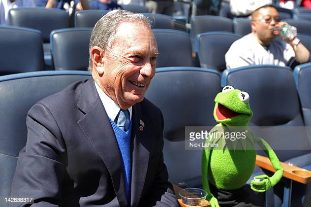 Mayor of New York City Michael Bloomberg sits in the front row with Kermit the Frog during the New York Yankees home opener against the Los Angeles...