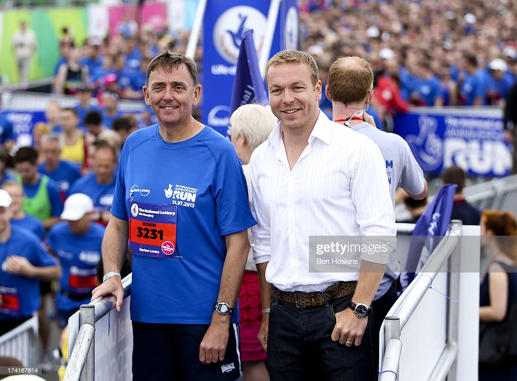 Mayor of Newham Sir Robin Wales (L) and Sir <a gi-track='captionPersonalityLinkClicked' href=/galleries/search?phrase=Chris+Hoy&family=editorial&specificpeople=171259 ng-click='$event.stopPropagation()'>Chris Hoy</a> look on prior to The National Lottery Anniversary Run at The Queen Elizabeth Olympic Park on July 21, 2013 in Stratford, England.