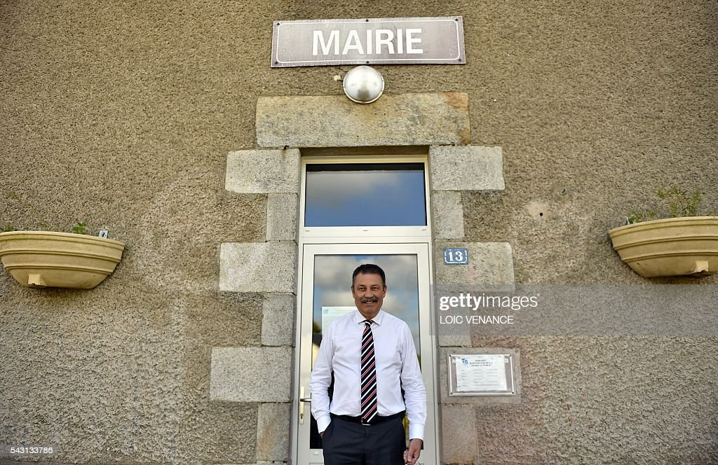 Mayor of Notre-Dame-des-Landes, Jean-Paul Naud, poses on June 26, 2016, in Notre-Dame-des-Landes during a local referendum organized in Loire Atlantique regarding the transfer of the Nantes Atlantique airport to Notre-Dame-des-Landes. Nearly One million people living in France's Loire-Atlantique department are voting in a referendum which poses the question 'Are you in favour of the project to transfer the Nantes-Atlantique airport to the municipality of de Notre-Dame-des-Landes?' to voters. The referendum was organised by the French executive power hoping to find a solution to the issue which has dragged on for 50 years. / AFP / LOIC