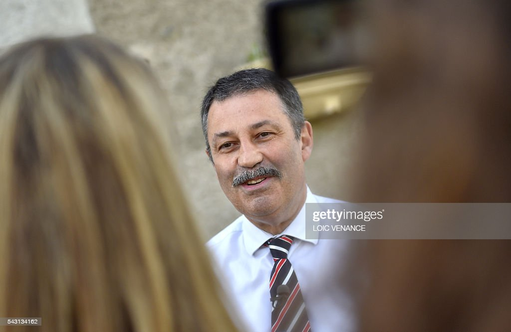 Mayor of Notre-Dame-des-Landes, Jean-Paul Naud, talks to journalists on June 26, 2016, in Notre-Dame-des-Landes during a local referendum organized in Loire Atlantique regarding the transfer of the Nantes Atlantique airport to Notre-Dame-des-Landes. Nearly One million people living in France's Loire-Atlantique department are voting in a referendum which poses the question 'Are you in favour of the project to transfer the Nantes-Atlantique airport to the municipality of de Notre-Dame-des-Landes?' to voters. The referendum was organised by the French executive power hoping to find a solution to the issue which has dragged on for 50 years. / AFP / LOIC