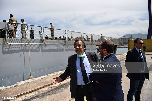 Mayor of Palermo Leoluca Orlando who said 'once again Palermo confirm itself as a welcoming city' looks on as migrants sit waiting to disembark from...