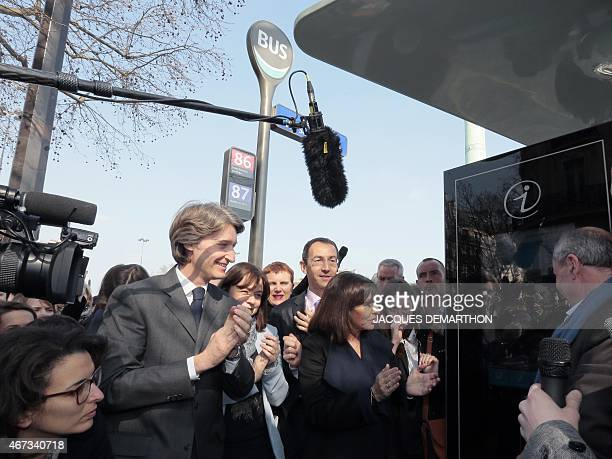 Mayor of Paris Anne Hidalgo and JeanCharles Decaux chairman of the board and coCEO of multinational advertising corporation JCDecaux clap during the...