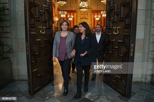 Mayor of Paris Anne Hidalgo and Mayor of Barcelona Ada Colau leave after signing a collaboration agreement between their two cities at the city hall...