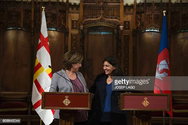 Mayor of Paris Anne Hidalgo and Mayor of Barcelona Ada Colau smile after signing a collaboration agreement between their two cities at the city hall...