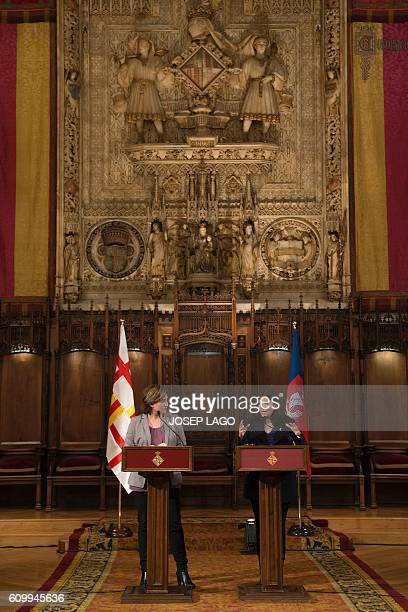 Mayor of Paris Anne Hidalgo and Mayor of Barcelona Ada Colau speak prior to signing a collaboration agreement between their two cities at the city...