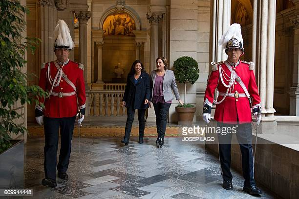Mayor of Paris Anne Hidalgo and Mayor of Barcelona Ada Colau walk to sign a collaboration agreement between their two cities at the city hall of...