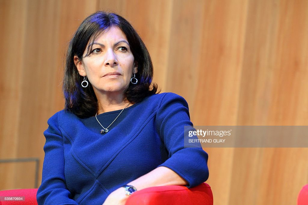 Mayor of Paris Anne Hidalgo attends a press conference about tourism in Paris on May 30, 2016 in Paris. / AFP / BERTRAND
