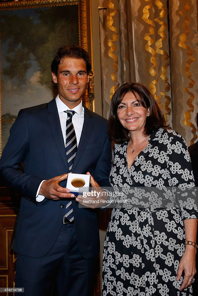 Mayor of Paris Anne Hidalgo (R) Awards the 'Grand Vermeil' Medal to Tennis player Rafael Nadal at Mairie de Paris on May 21, 2015 in Paris, France.