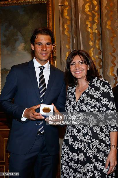 Mayor of Paris Anne Hidalgo Awards the 'Grand Vermeil' Medal to Tennis player Rafael Nadal at Mairie de Paris on May 21 2015 in Paris France