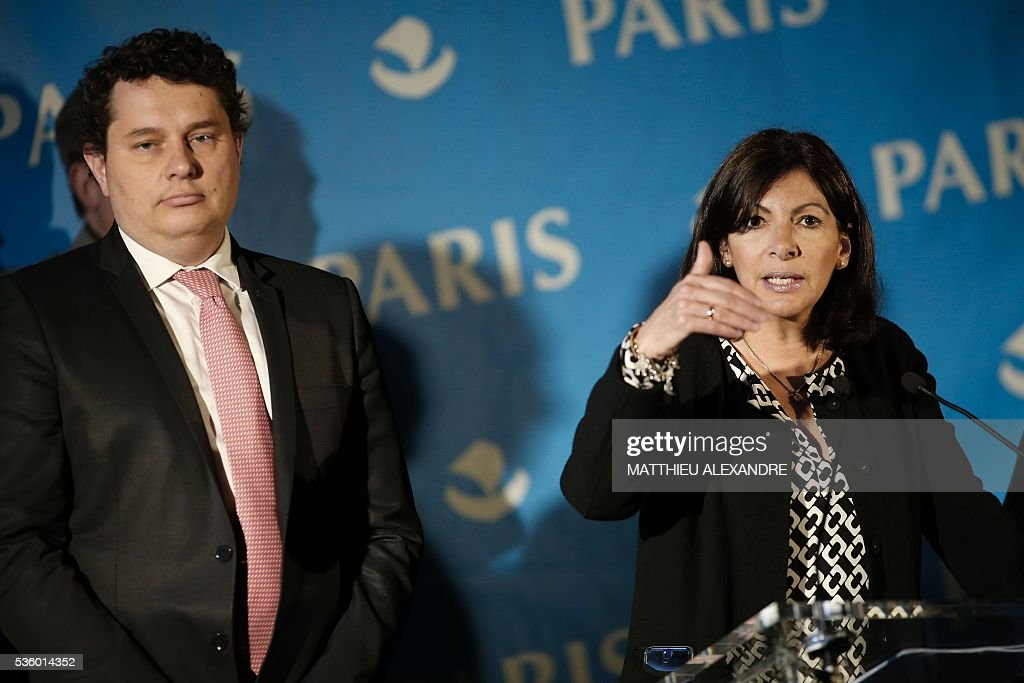 Mayor of Paris Anne Hidalgo (R), flanked by Mayor of 18 district, Eric Lejoindre (L) gives a press conference regarding the creation of an official camp to welcome migrants on May 31, 2016 in Paris. The mayor of Paris said on Tuesday she wanted to create a refugee camp in the French capital to replace makeshift camps that are habitually closed down for health reasons. City authorities are 'assessing different sites' for their suitability to create a camp 'as soon as possible', Mayor Anne Hidalgo told during a press conference. ALEXANDRE