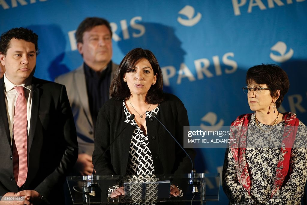 Mayor of Paris Anne Hidalgo (C), flanked by Mayor of 18th district, Eric Lejoindre (1st-L), France Terre d'Asile Director Pierre Henry (2nd-L) and Social associations representatives, gives a press conference regarding the creation of an official camp to welcome migrants on May 31, 2016 in Paris. The mayor of Paris said on Tuesday she wanted to create a refugee camp in the French capital to replace makeshift camps that are habitually closed down for health reasons. City authorities are 'assessing different sites' for their suitability to create a camp 'as soon as possible', Mayor Anne Hidalgo told during a press conference. ALEXANDRE