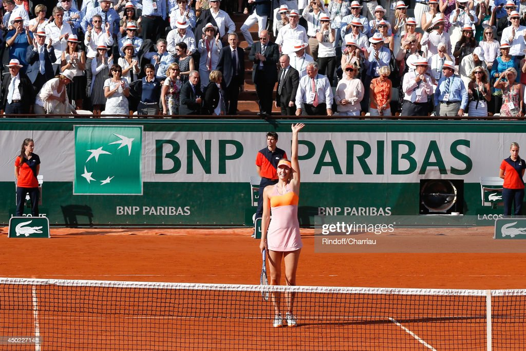 Mayor of Paris Anne Hidalgo, Minister of Women's Rights, the City and the Youth and Sports Najat Vallaud-Belkacem and President of FFT Jean Gachassin tennis player Maria Sharapova wins the Roland Garros French Tennis Open 2014 - Day 14 on June 7, 2014 in Paris, France.