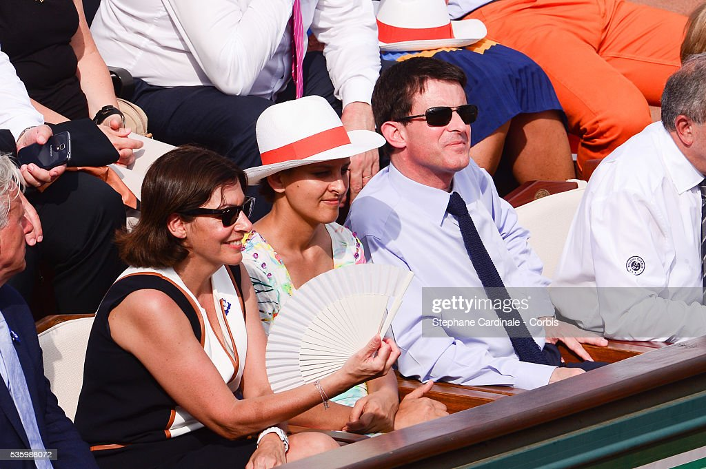Mayor of Paris Anne Hidalgo, Minister of Women's Rights, the City and the Youth and Sports Najat Vallaud-Belkacem and French Prime Minister Manuel Valls attend the Men's Final of Roland Garros French Tennis Open 2014 - Day 15 on June 8, 2014 in Paris