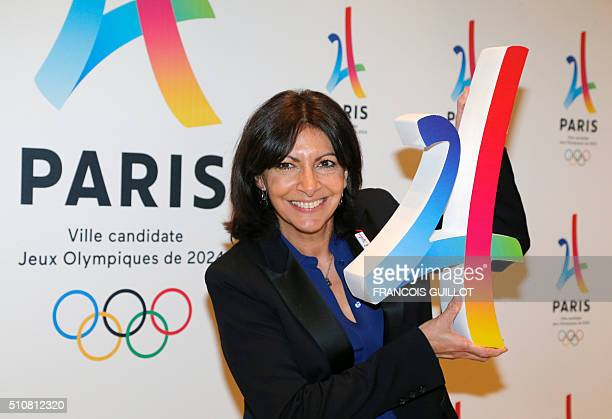 Mayor of Paris Anne Hidalgo poses with the logo of Paris as candidate for the 2024 Olympic summer games during a press conference in Paris on...