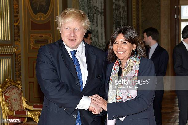 Mayor of Paris Anne Hidalgo receives the Mayor of London Boris Johnson at Hotel de Ville on February 5 2015 in Paris France The meeting was arranged...