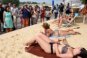 Mayor of Paris Anne Hidalgo talks to sunbathing women as she visits 'Paris Plage' during the opening day of the event on the bank of the Seine river...