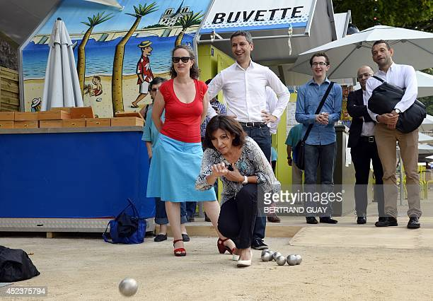 Mayor of Paris Anne Hidalgo throws a petanque ball next to Colombe Brossel deputy mayor in charge of green spaces nature biodiversity and funeral...