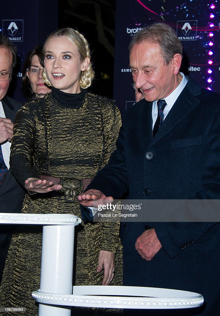 Mayor of Paris Bertrand Delanoe and actress <a gi-track='captionPersonalityLinkClicked' href=/galleries/search?phrase=Diane+Kruger&family=editorial&specificpeople=202640 ng-click='$event.stopPropagation()'>Diane Kruger</a> attend the switching on of the Christmas lights along the Champs Elysees on November 21, 2012 in Paris, France.