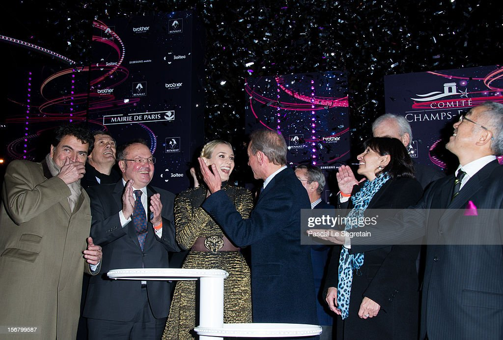 Mayor of Paris Bertrand Delanoe (C) and actress Diane Kruger (4th left) attend the switching on of the Christmas lights along the Champs Elysees on November 21, 2012 in Paris, France.