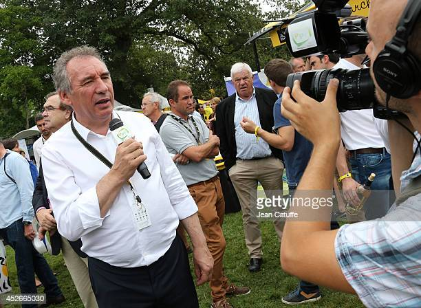Mayor of Pau Francois Bayrou answers to media before the start of stage eighteen of the 2014 Tour de France a 146 km road stage from Pau to Hautacam...