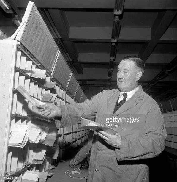 Mayor of Preston Councilor CE Molyneux sorts mail at the Preston Post Office branch in Lancashire He has been a Post Office worker since 1946